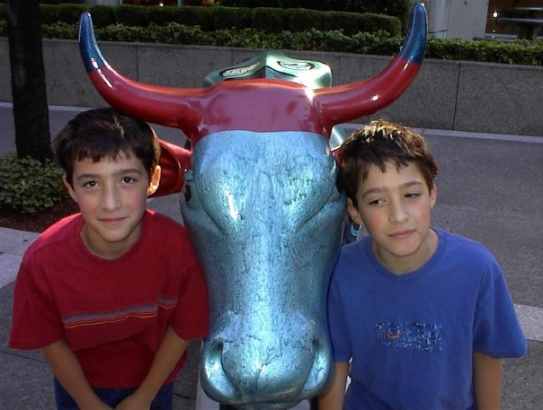 twins with cow statue